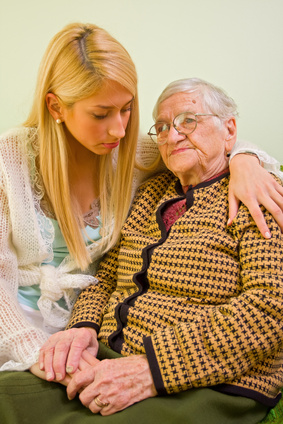 Granddaughter comforting grandmother with Alzheimers
