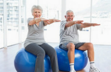 senior-couple-exercising-indoors